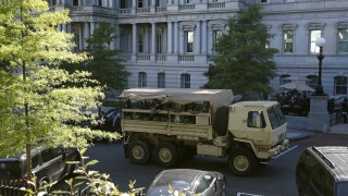 Active troops, military vehicles guard the White House