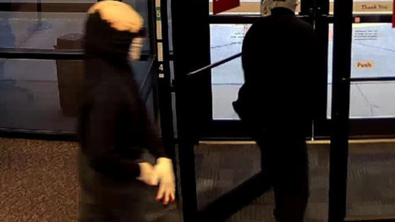 Police search for bank robbery suspects