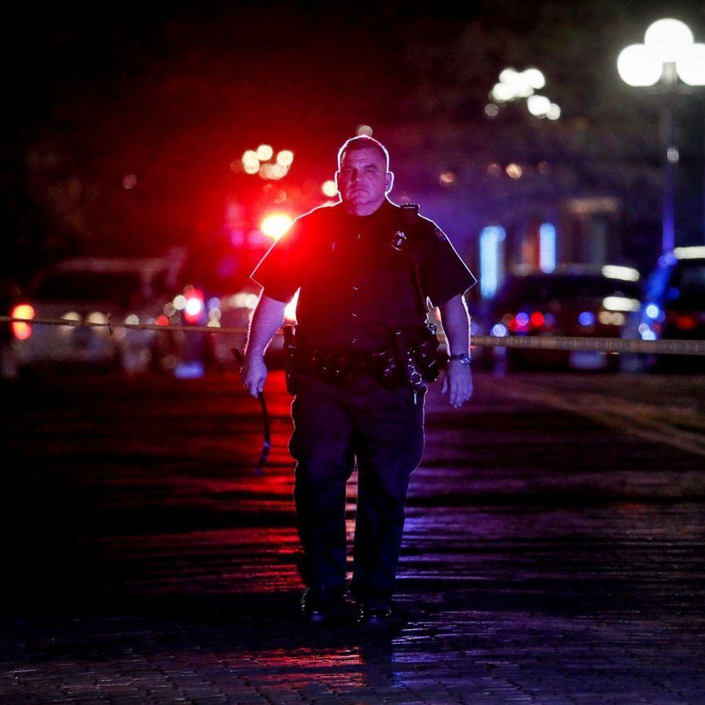 Authorities work at the scene of a mass shooting, Sunday, Aug. 4, 2019, in Dayton, Ohio (John Minchillo/AP).