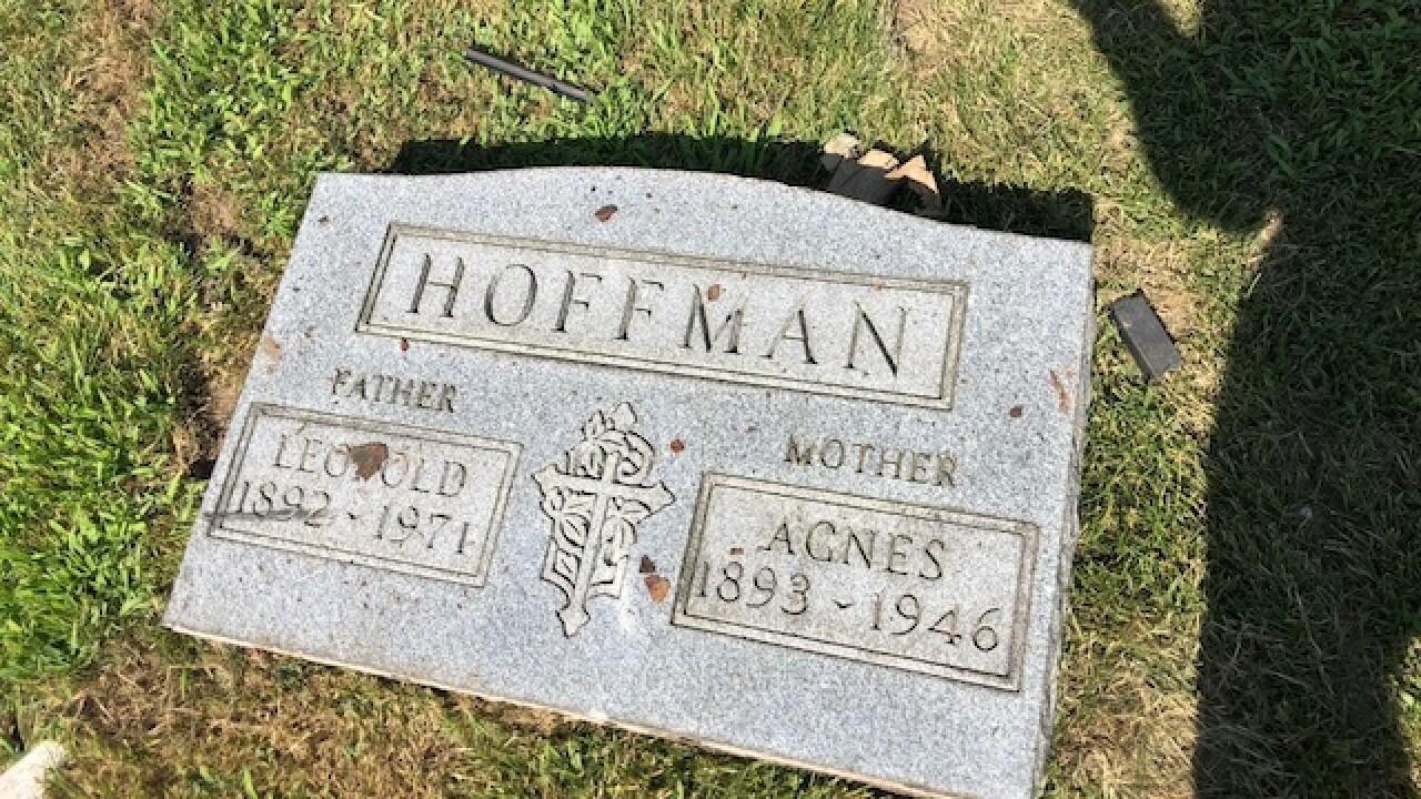 Drivers plows through Akron cemetery