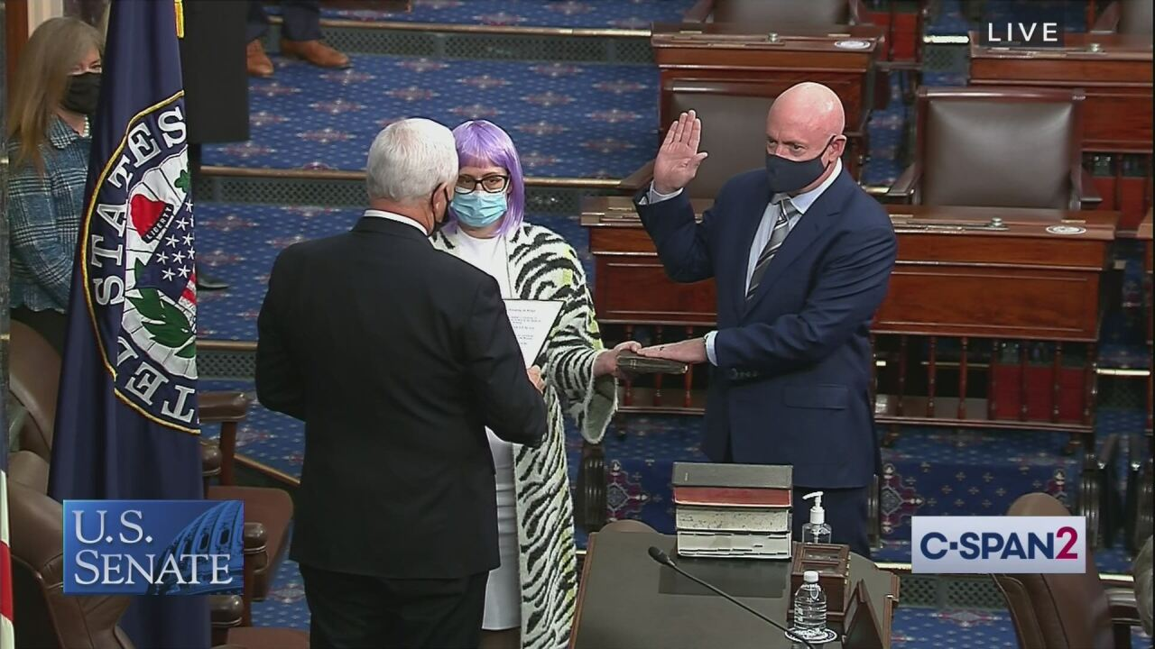 Here's why Sen. Kyrsten Sinema wore a wig to Mark Kelly's swearing-in ceremony