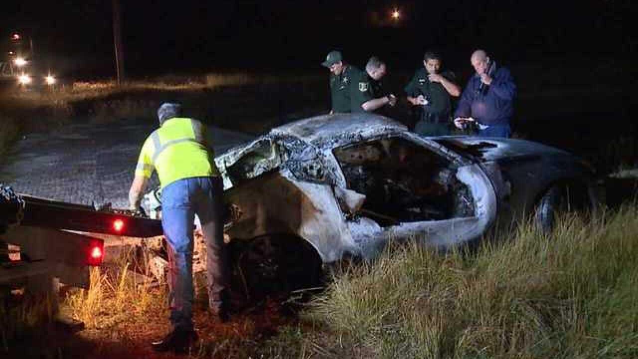 Burned car in Lehigh Acres canal