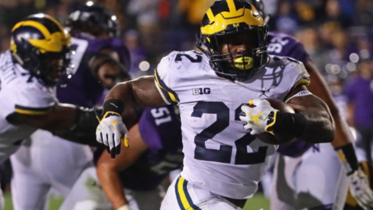 Michigan RB Karan Higdon packed on muscle to give, take pounding