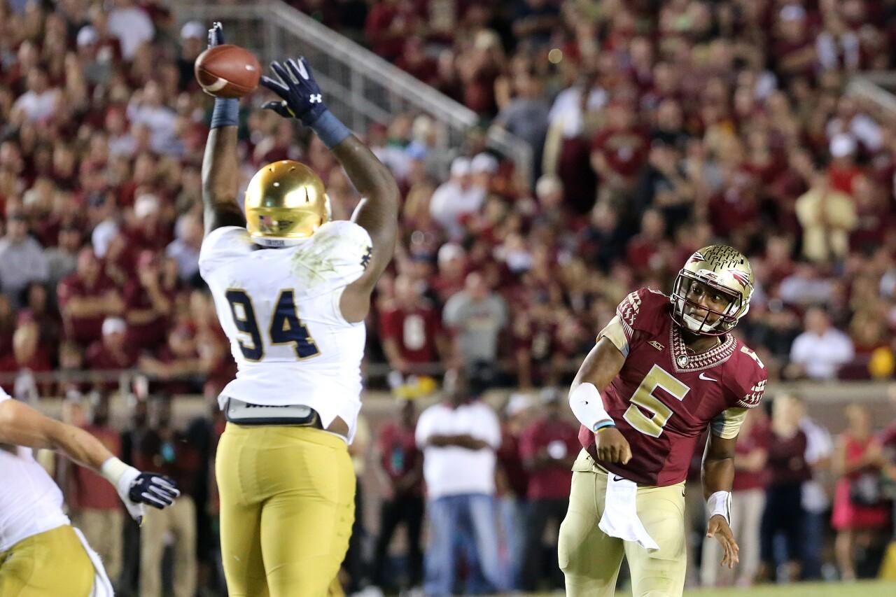 Florida State Seminoles QB Jameis Winston throws pass vs. Notre Dame Fighting Irish in 2014
