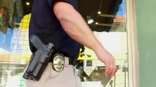 wptv-officer-with-gun-.jpg