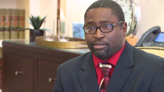 He tried to deposit his checks from a racial discrimination settlement. The bank called the police