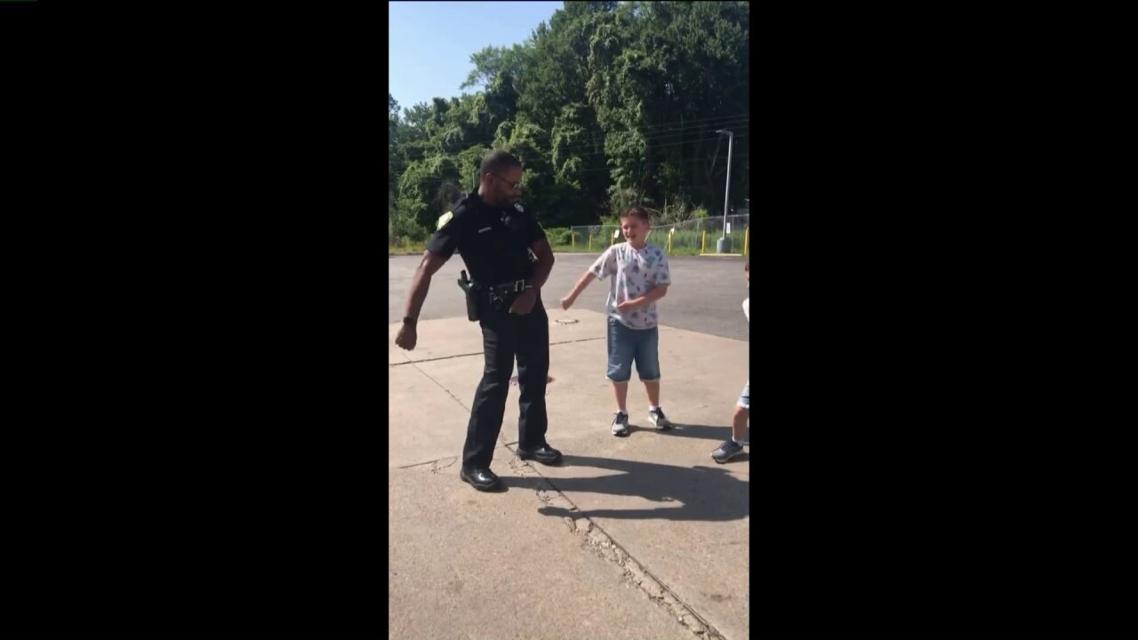 Funny video: Isle of Wight deputy attempts to learn dance moves from localchildren