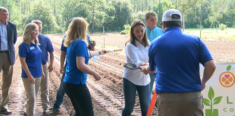 Photo by WTXL. Agriculture Commissioner Nikki Fried at Lott's Garden with Second Harvest of the Big Bend.
