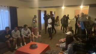 Locals host an Olympic watch party; Chelimo wins the Bronze