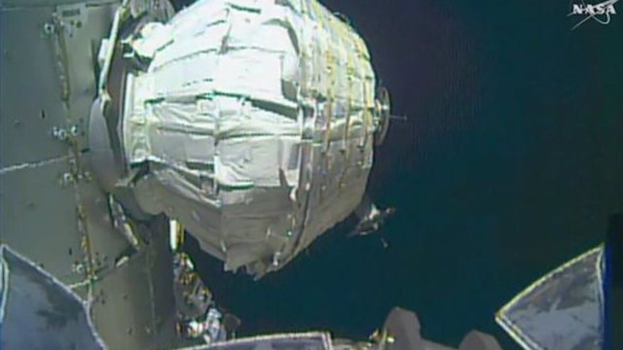 Spacewalking astronauts install new front door for visitors