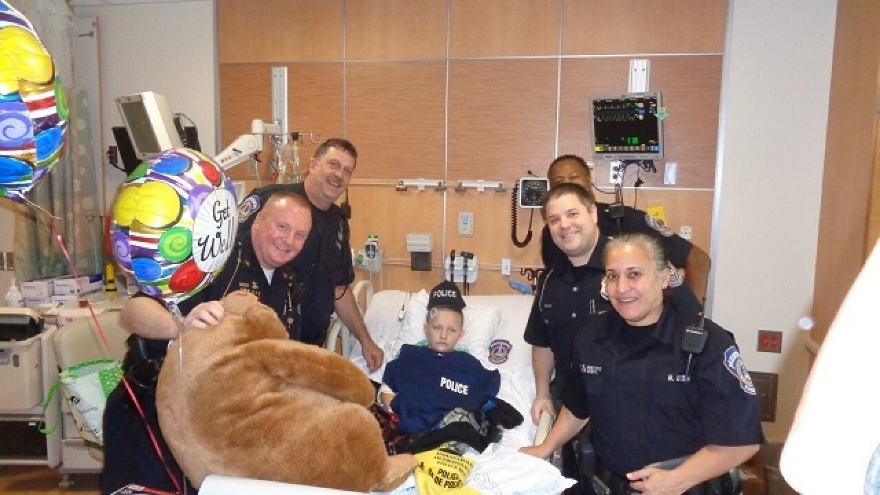 PHOTOS: IMPD officers visit Riley Hospital
