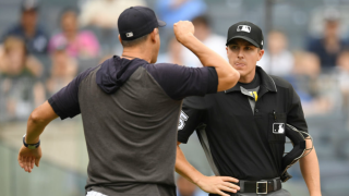 Aaron Boone argues with home plate umpire Brennan Miller