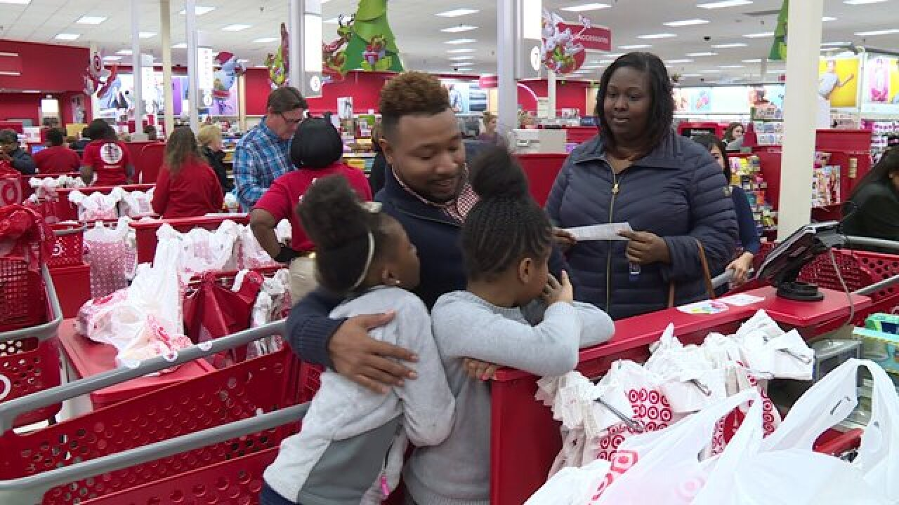 Raymond helps family complete last-minute Christmas shopping