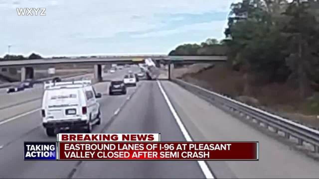 Freeway closure after semi hits overpass