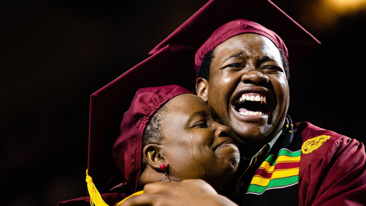 Mom skips her own graduation to attend her son's