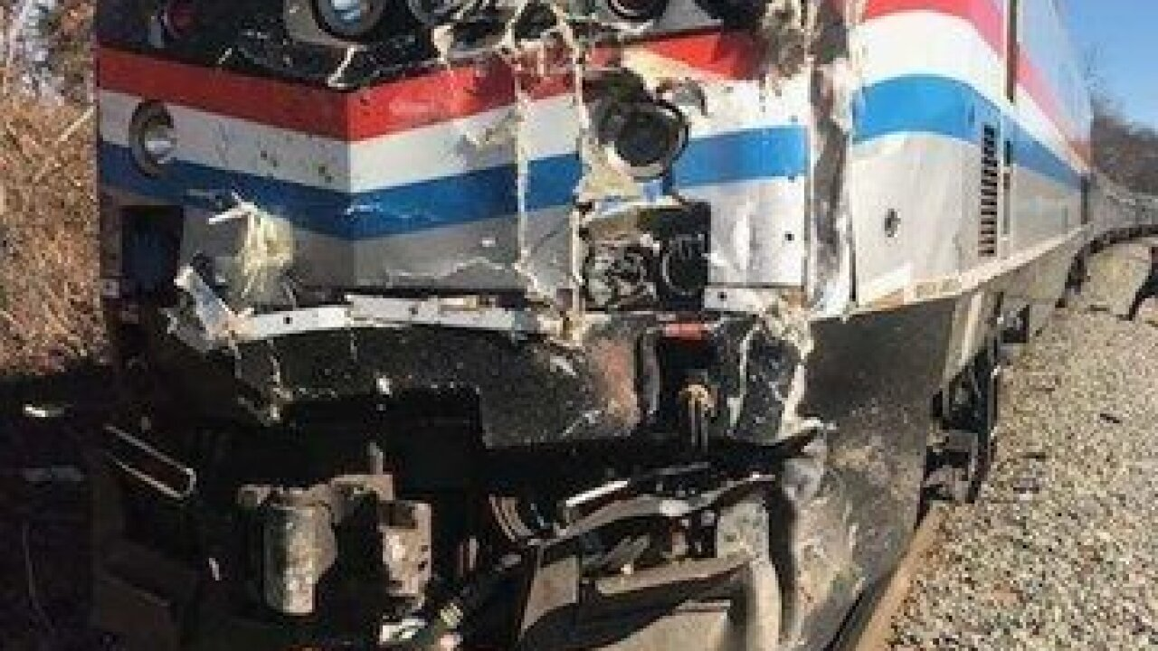 Train carrying members of Congress hits a truck