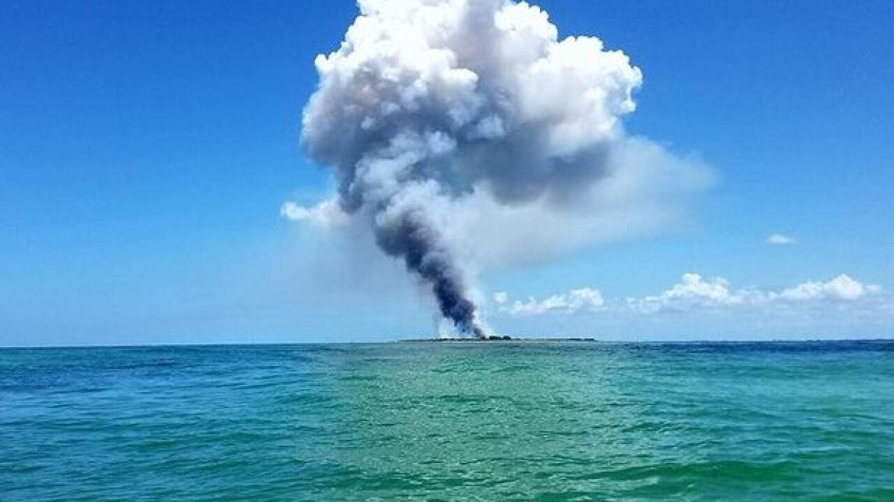 Crews battling fire on Egmont Key
