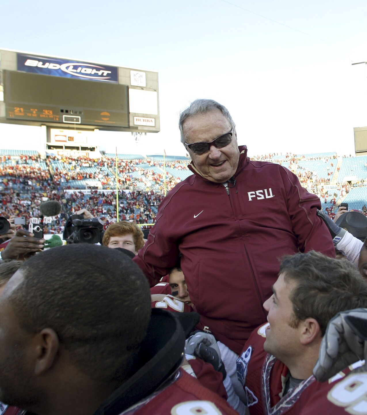 Florida State Seminoles head coach Bobby Bowden carried off field after 2010 Gator Bowl victory