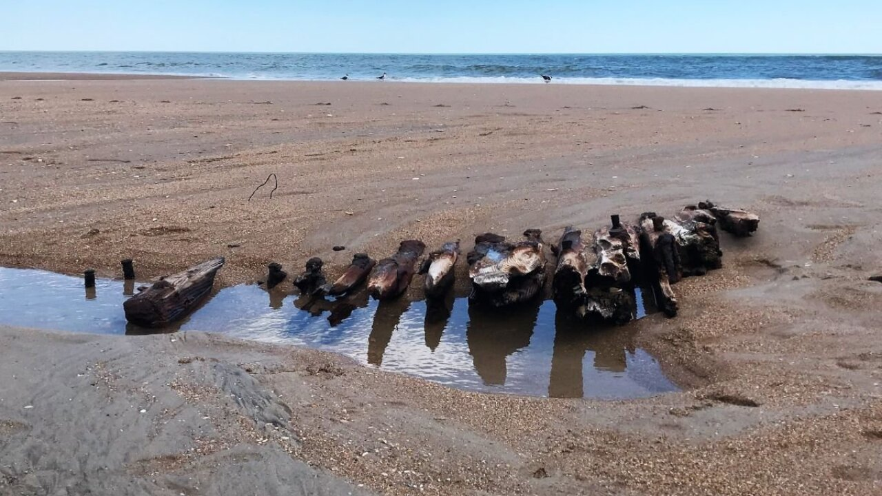 Tides uncover a century-old shipwreck on North Carolina's shore