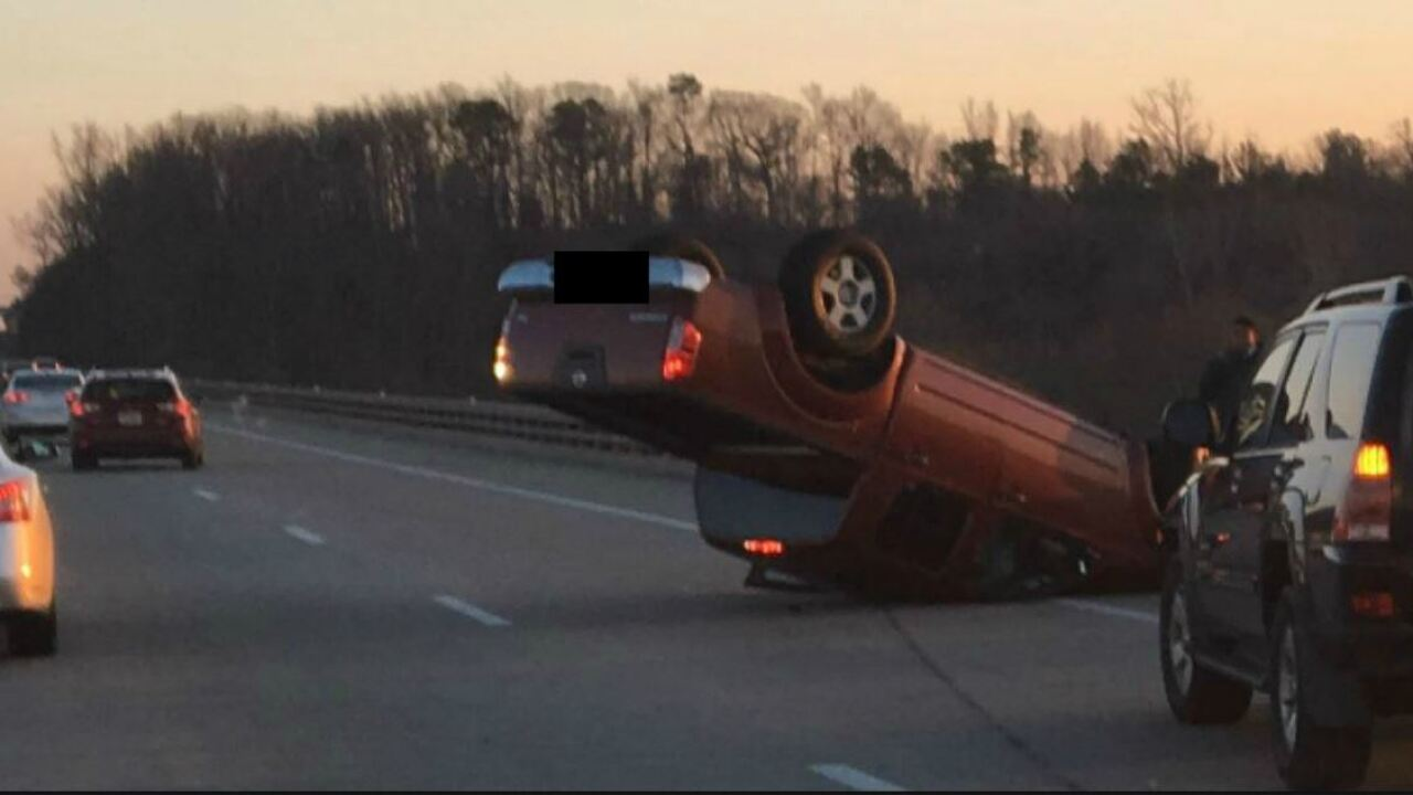 Photo shows flipped truck on 288