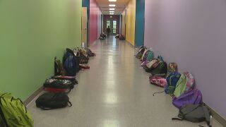 Backpacks in the hall. Learning in the Classroom.