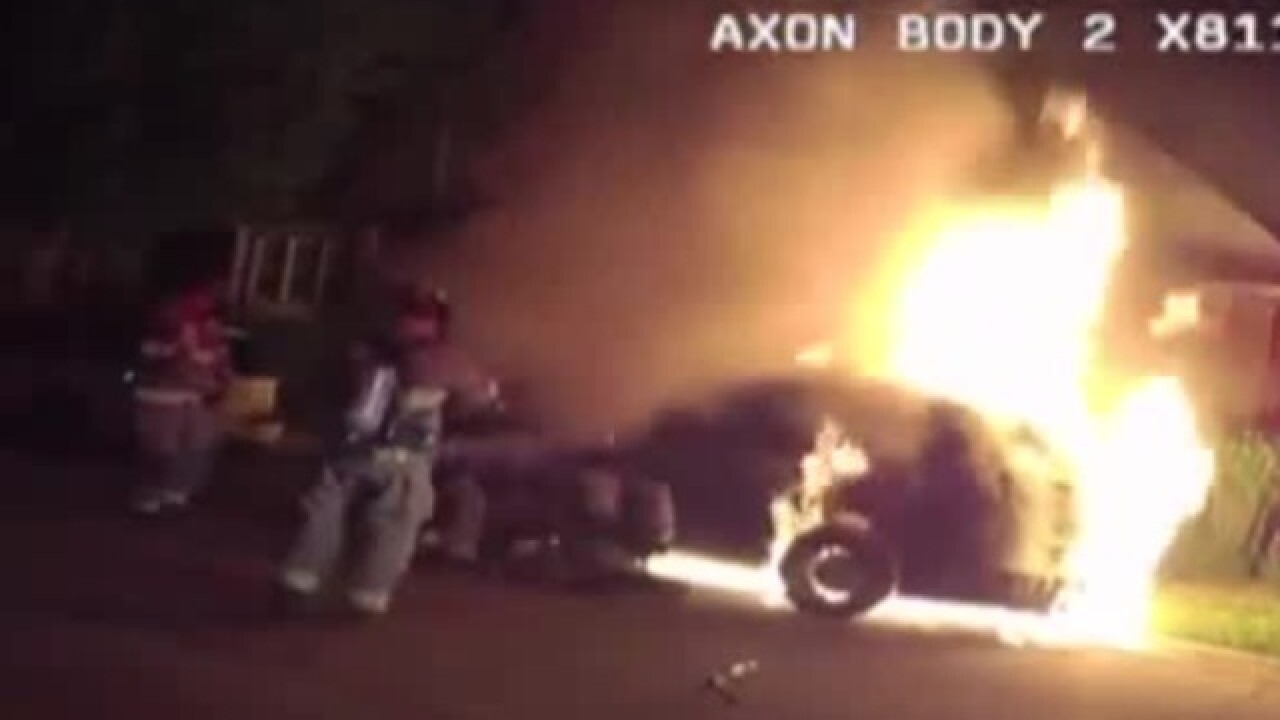 VIDEO: Firefighters rescue person from car fire