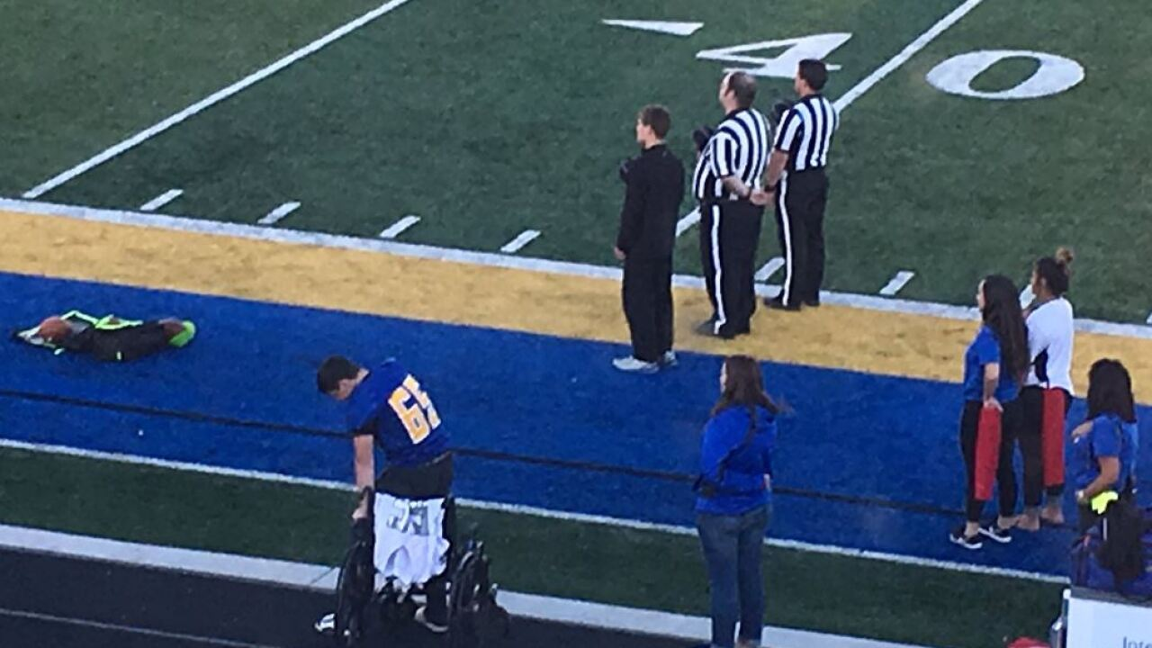 Orem football player who rose from wheelchair for national anthem shares his story