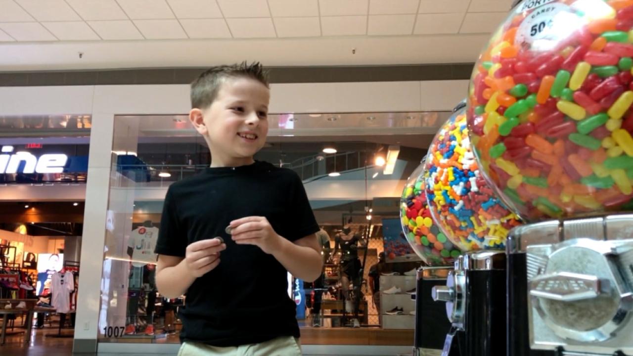 Mark Effron leaving quarters on candy machine