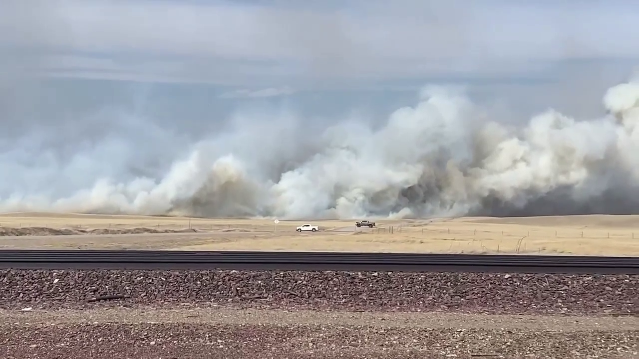 Wildland fire spreads near Browning