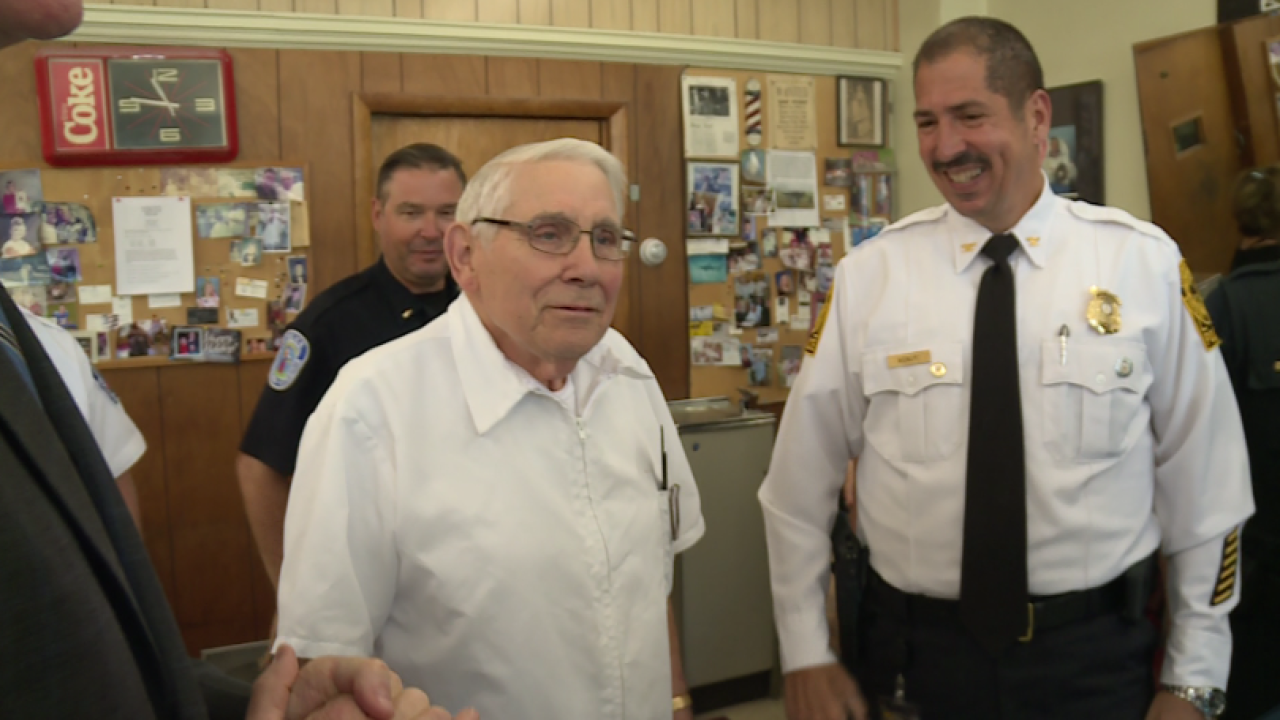 Longtime Richmond barber 'Mr. Adams' honored for 60 years inbusiness