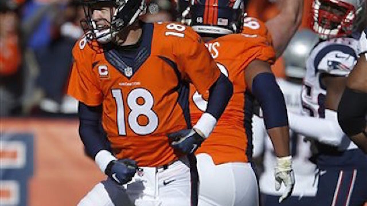 fc24c819 Manning, Broncos hang on to beat Brady, Patriots