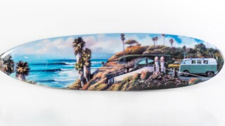 Artist Wade Koniakowsky displays surfboard for grand opening of Art Alley in Solana Beach.
