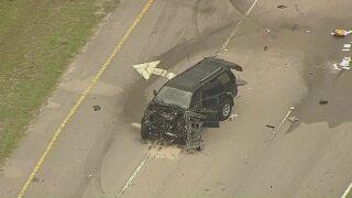 badly damaged SUV in middle of Northlake Boulevard