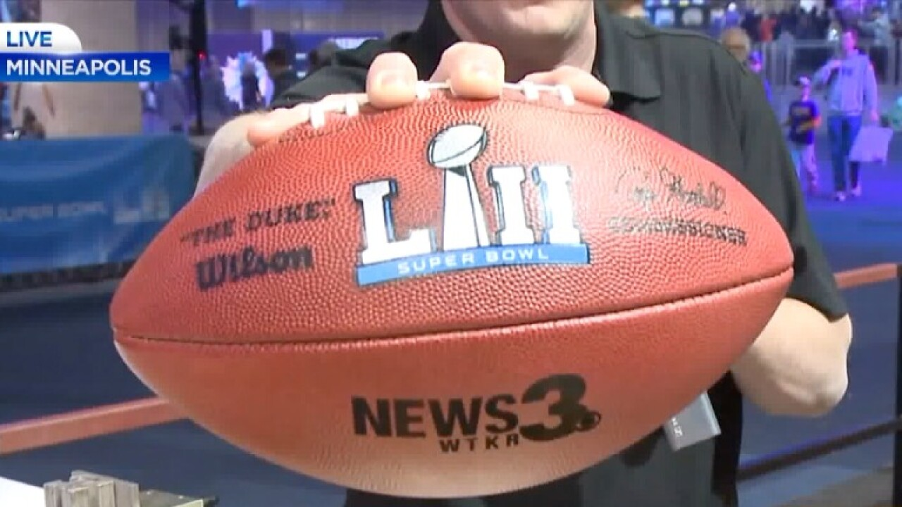 Fans in Minnesota experience how a Super Bowl football is made
