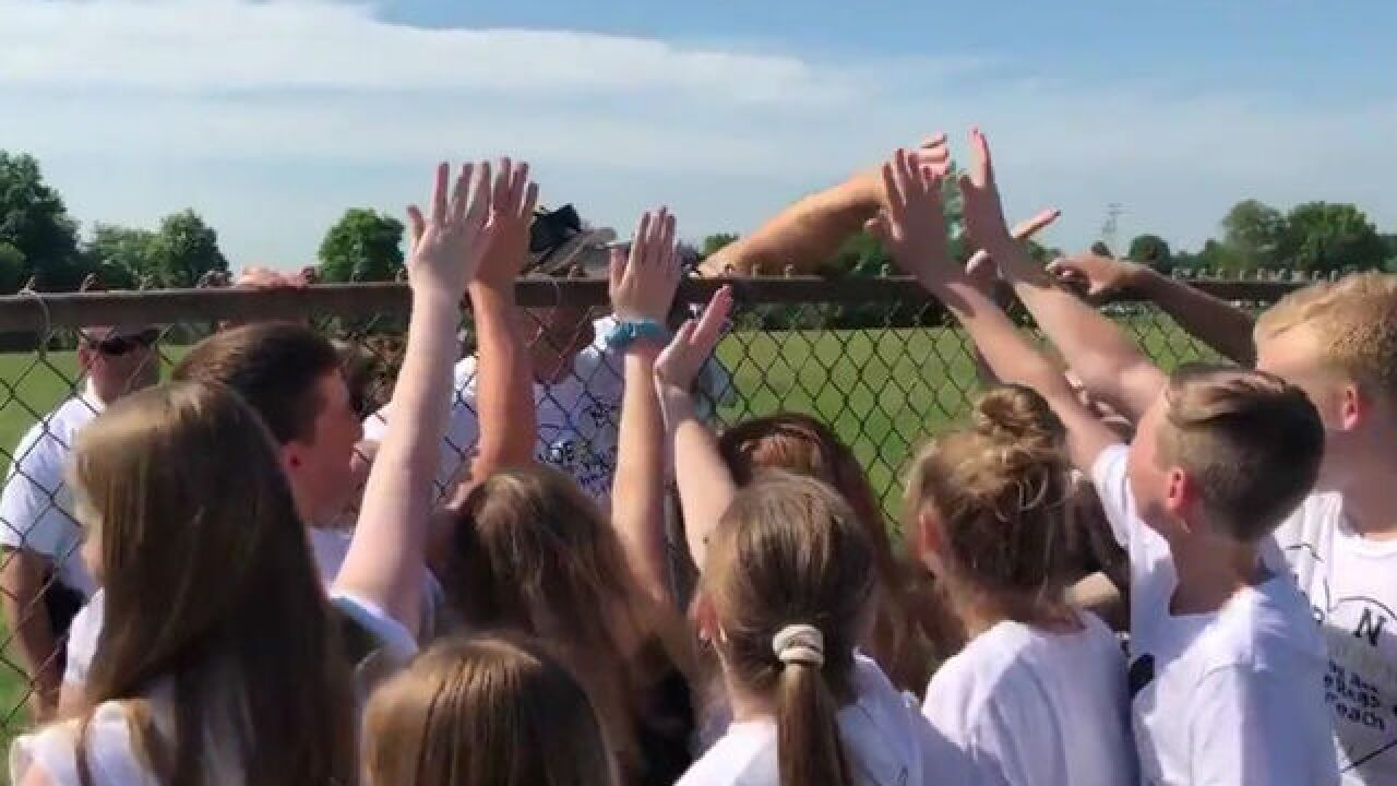 WATCH: Hero teacher meets students at game