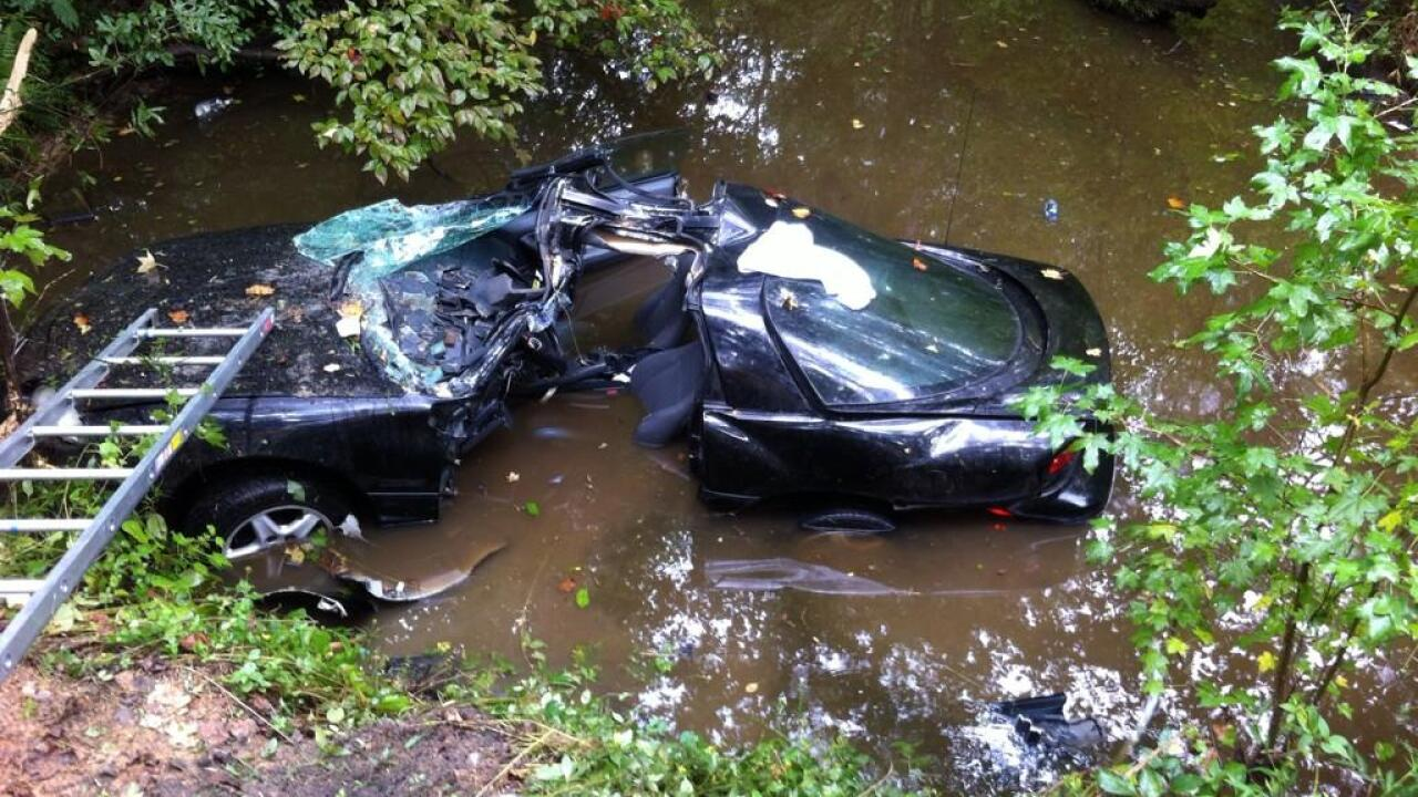 Crews rescue driver after car slams into tree, lands in creek