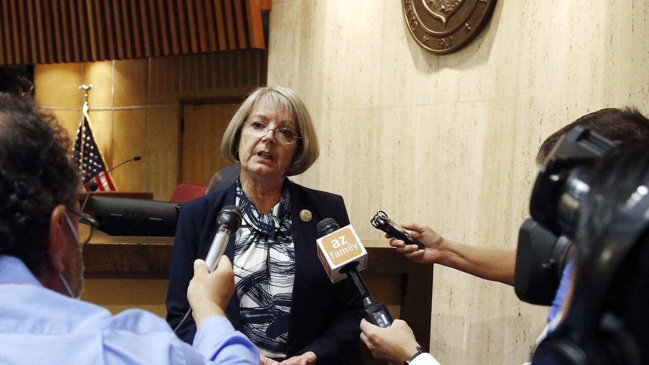 A pair of Republican Arizona lawmakers who objected to a $1.9 billion tax cut in a $12.8 billion GOP budget deal are close to winning major concessions that would secure their support for the spending plan. But a deal expected to be finalized Thursday came to a halt over the tax cut's effects on city revenue.  AP photo.