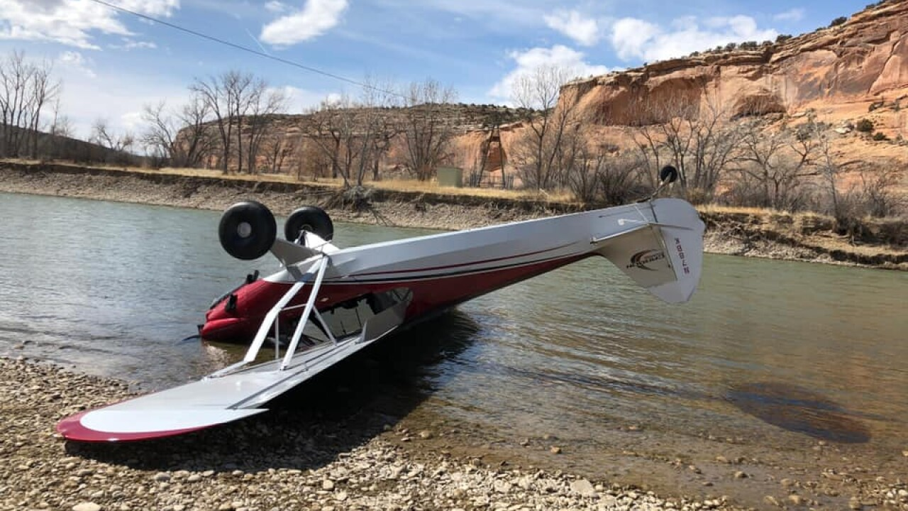 A small airplane crashed on the bank of the Colorado River Saturday near the Utah-Colorado border