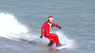 Santa surfing Lake Erie