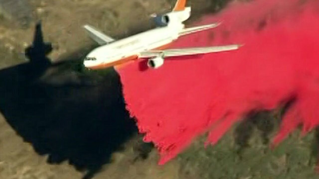 Anaheim wildfire continues to threaten homes