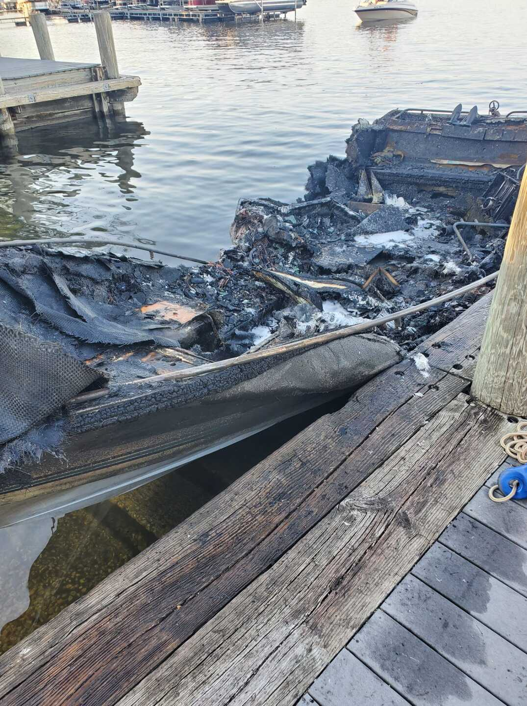 The remains of a boat that caught fire on Pewaukee Lake Saturday evening. (Photo credit: Kim Schemehorn)