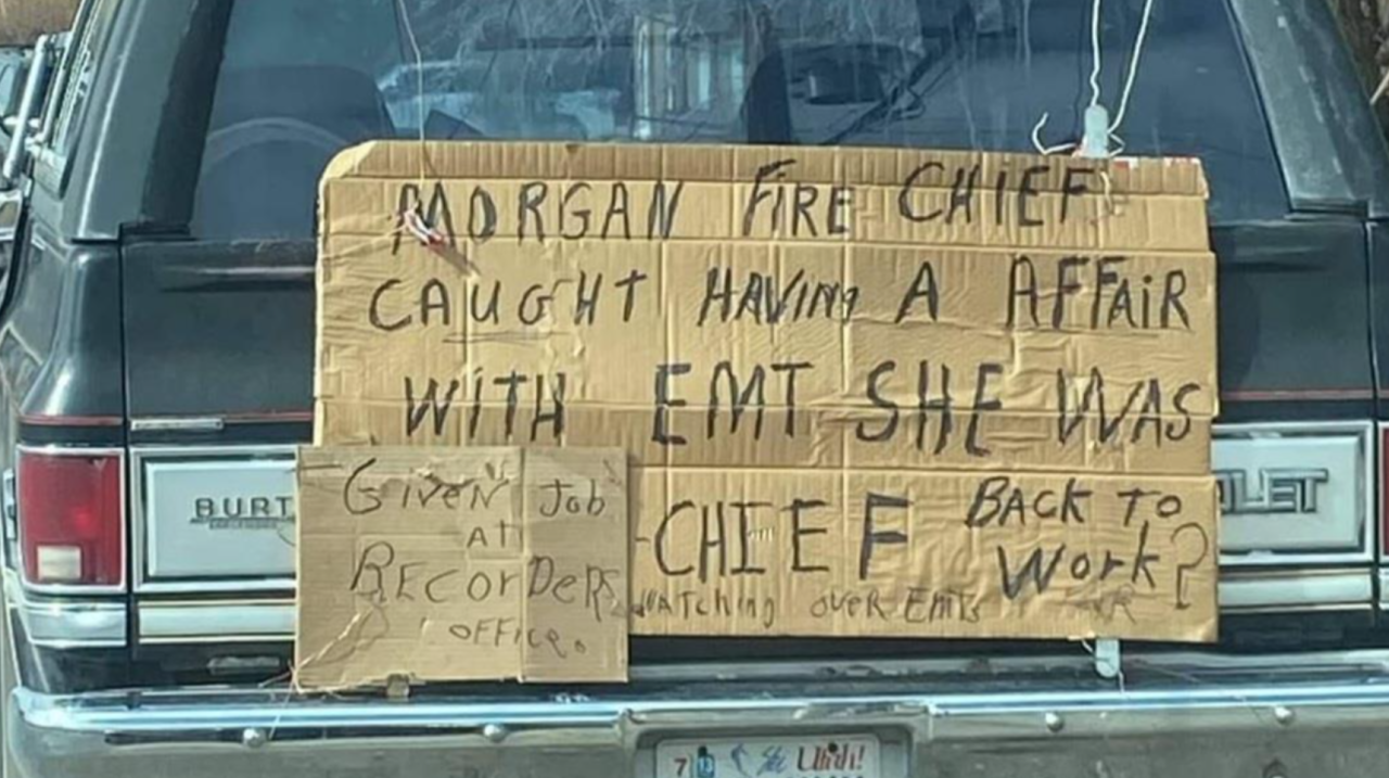 Mike Ingle posted this cardboard sign on his truck after his grandson was terminated from the Morgan County Fire Department.