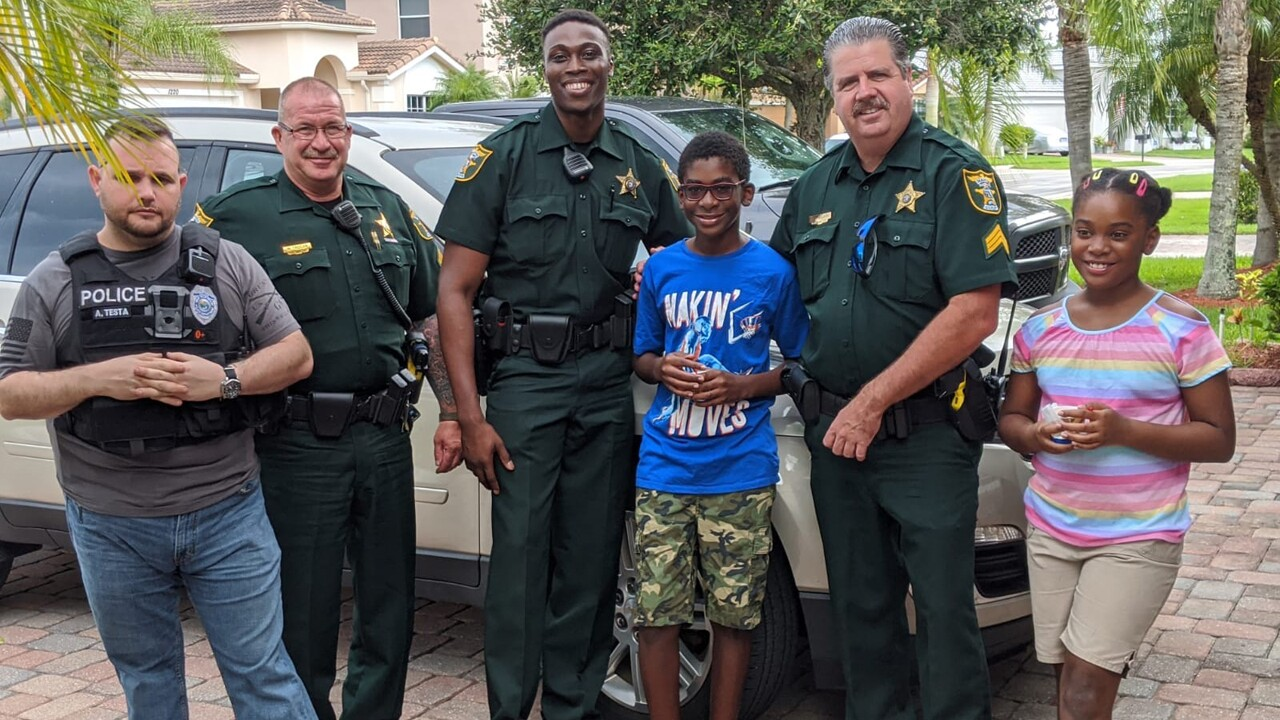Officers with members of the Maxwell family.