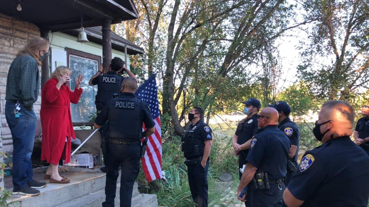Utah woman breaks American flag fending off intruder, police replace it