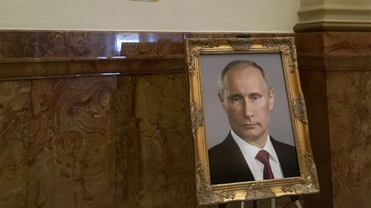Colorado legislative aide punished for Putin portrait prank
