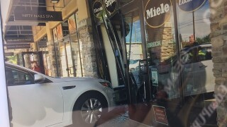 PHOTOS: Car slams into Vacuum Authority storefront on Indy's north side