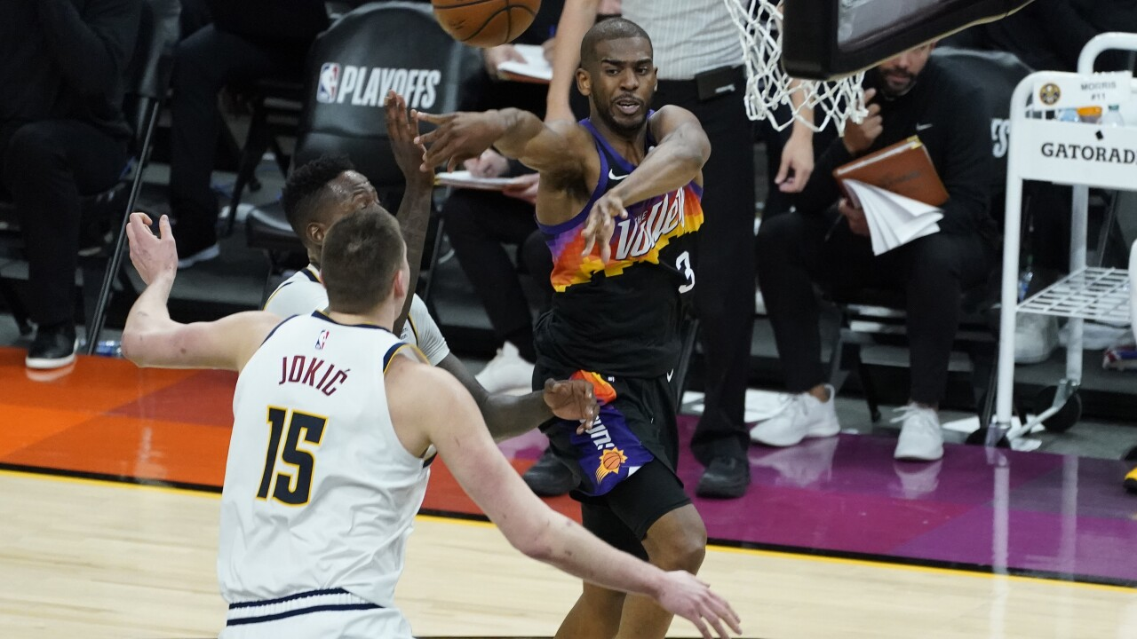 Chris Paul and his rejuvenated right shoulder scored 21 points and dished 11 assists, Mikal Bridges added 23 points and the Phoenix Suns beat the Denver Nuggets 122-105 in Game 1 of the Western Conference semifinals. AP photo.