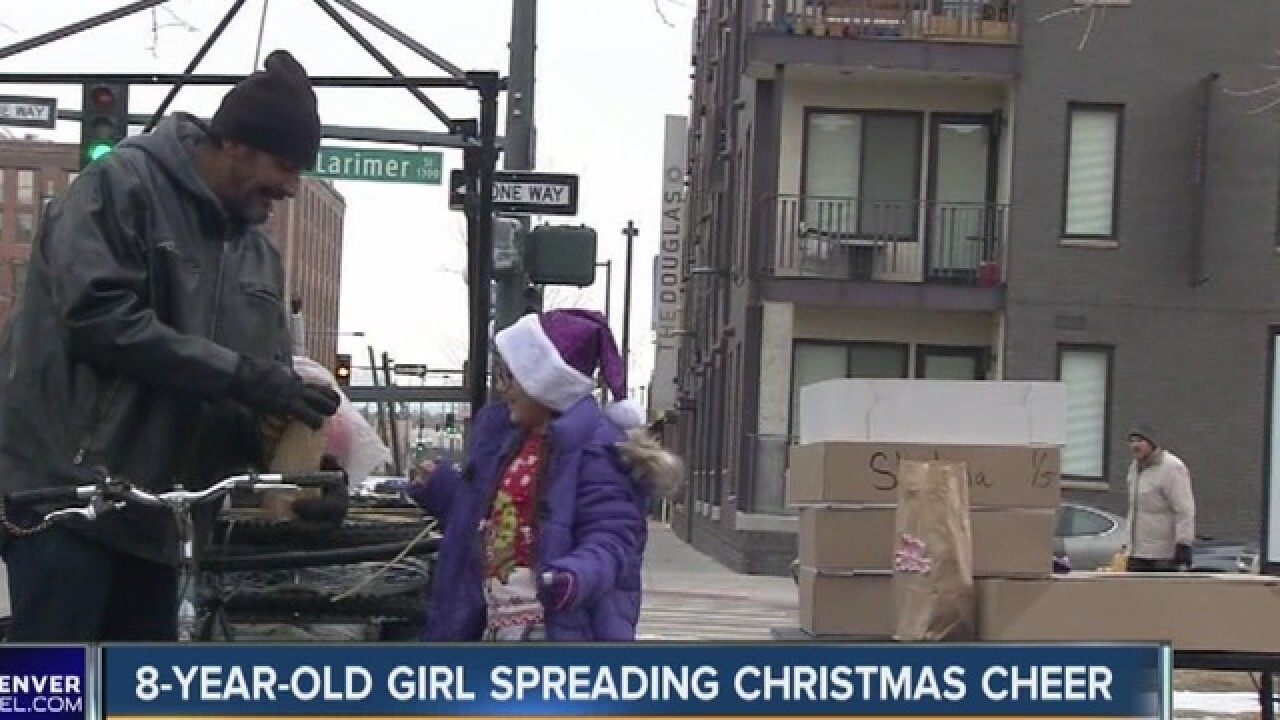 Autistic girl gives Christmas cheer to homeless