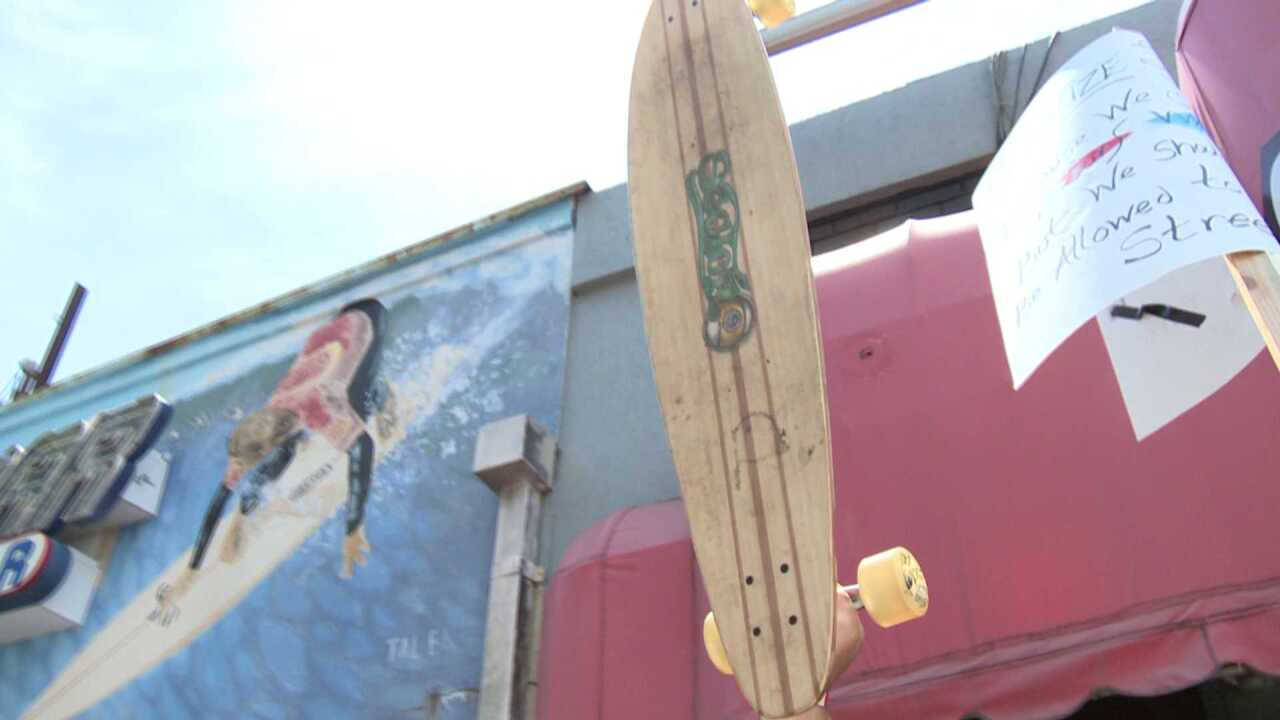 Skateboard repels cougar attack