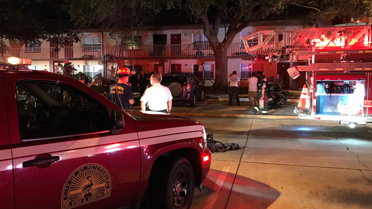 Firefighters pull unconscious woman from fire
